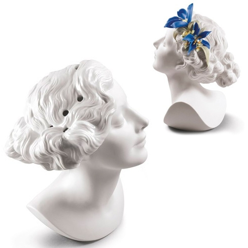 Lladró Daisy Vase sculpted by Raul Rubio. The vase version hides 9 holes to create ever changing floral tiaras around her head.