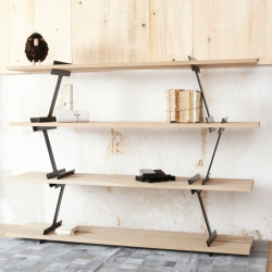 Damien Gernay imagined this shelving system, Lumberjack. as simple and rough as the stroke of the axe to cut the log in two.