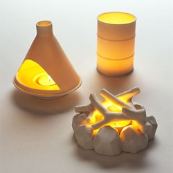 David Weeks little votive candle look like miniature fireplaces