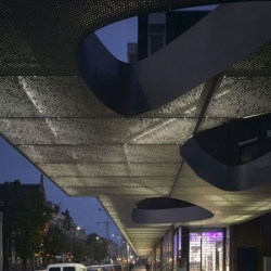 The re-development of 'De Boogjes' by  Mecanoo Architecten grouped 4 blocks of buildings into a single entity with two bookends-like awning displaying a changing selection of poems from Poetry International Rotterdam.