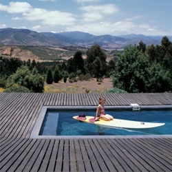 Deck House by Felipe Assadi, a wooden folded plane encloses a simple house, but with one of the best terraces i´ve seen, the perfect platform for a pool in front of the landscape.
