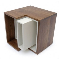 Martin Sprouse's Delete table - a white Corian spine surrounded by a solid walnut surface provides the table's structure and creates storage for magazines.