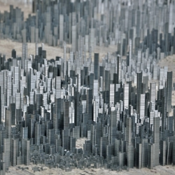 Artist Peter Root latest work is 'Ephemicropolis', a metropolis made completely from stacks of metal staples. [an expanded version of low rise #29379?]