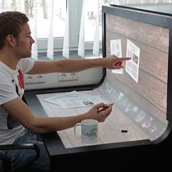 Bend Desk is a prototype interactive display that takes the digital workspace from the screen to the desktop by the media computing group at RWTH Aachen University.