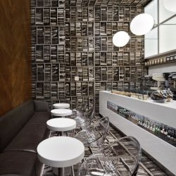 Nema Workshop  have completed the interior design for a small cafe in New York City, where they took the concept of a library and turned it sideways.