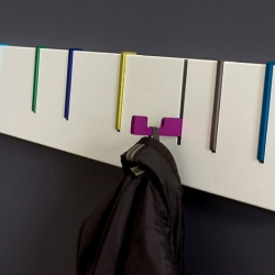 Symbol coat rack by DESU. I love the way each hook folds away when not in use.