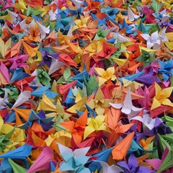 "Artist / designer James Roper presents ""Devotion,"" an installation project consisting of approximately 10,000 hand-folded paper flowers, folded 10 a day for three years straight! Installed in several starry formations."
