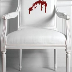 """Amy Lau  is featuring limited edition designs inspired by the TV show """"Dexter"""" -- including this white ultraleather chair with embroidered blood spatter"""