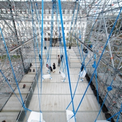 German studio J. Mayer H. Architekten created a temporary gallery made from scaffolding and features swinging seats at a modern art museum in Munich.