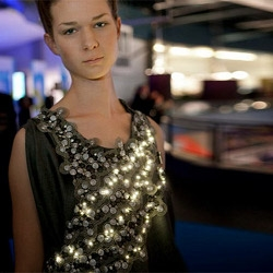 This radiant dress shines with hundreds of LED lights that pulsate based on the quality of the local air.