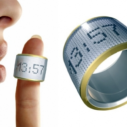 A designer got a great idea: instead of using common LCD screens, little balls are used to display things by electro-magnetism. In this example, it's a finger ring with a clock inside.