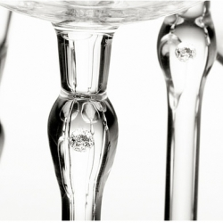 Diamonds in Glass (DIG) has come up with a new use for bling. They suspend real diamonds in the stems of glasses, keyrings, napkin rings, perfume bottles, ashtrays and of course, jewelry. They also have a video of the process on their site.