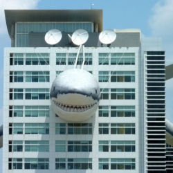 "In celebration of Discovery Channel's SHARK WEEK, ""Chompie"" is on the Discovery Communications headquarters in Silver Spring, MD.  The giant inflatable shark is 446 feet long from his nose to his tail, and took 6.65 miles of fabric to make."