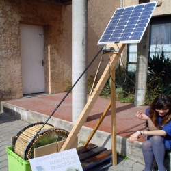 "Students at the École Supérieure d'Art d'Aix-en-Provence of France's ""Open Source Washing Machine Project"". Made from bicycle parts (tires and wheel), bamboo, a solar panel cand recycled electric motor."