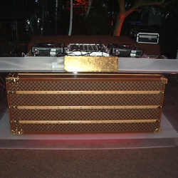 Aaron R. Thomas created this plexi DJ spinning table complete with Louis Vuitton trunk for the Golden Globes! Just one of his many fun acrylic designs!