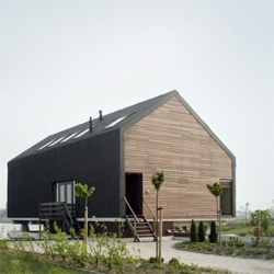 Djik House by Jager Janssen architecten. A house with a traditional roof, that  elevates the ground floor above the terrain to create a more intimate, yet open, common area.