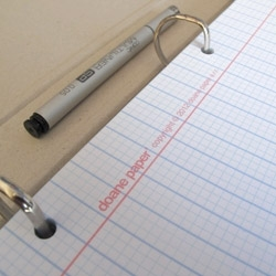 Doane Paper's grid + lines pattern finally makes it to a sheet of 3 hole drilled loose leaf notebook paper.