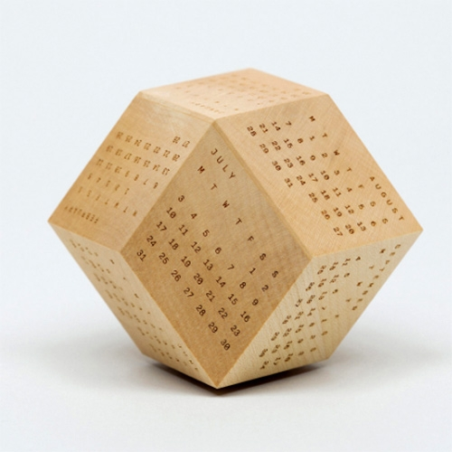 "DodeCal is ""an innovative polyhedra calendar system, designed with mathematical precision and finished in high quality European sycamore."" Laser etched wooden 2017 calendar - fun making of images on their site."