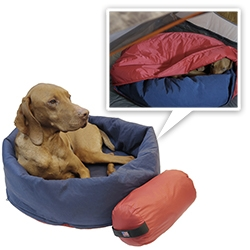 The 2-in-1 NOBLECAMPER is an Ultralight Compressible Travel Dog Bed that transforms into a Sleeping Bag.  The bottom zipper allows the sides of the bed to unfold and become a sleeping bag protecting your pooch from colder environments.