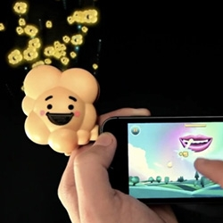 The Pop Dongle by Pop Secret: The First-Ever Smellable Mobile Game. Smell it while you play! By Deutsch Los Angeles and Deeplocal.