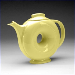 """The unique hole-in-the-middle shape of the Classic 'Donut' teapot has intrigued collectors since its introduction in 1937.""   hmmmmm."