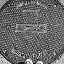 "How often you look to yourselves under legs? Small photo report ""under legs"" from photographer Dan Heller. Manholes of the USA"