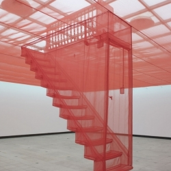 At the Psycho Buildings exhibition at the Hayward Do-Ho Suh stretched sheer red nylon to create a false ceiling with a set of stairs suspended from the centre looking like an entrance into an invisible attic.