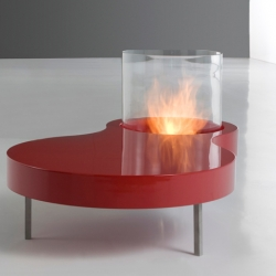 Planika Fire makes these incredible coffee tables with a built-fire pit. They burn on a green fuel that is smoke and odor free.