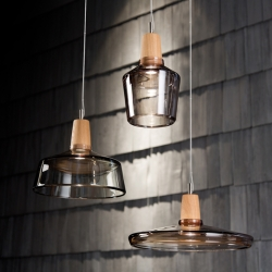 The Industrial Collection manufactured by dreizehngrad is inspired by the design of classic industrial lamps. Mouth-blown crystal glass combined with turned oak wood perform well together.
