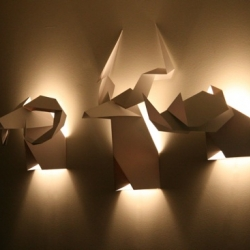 Origami Hunter. Sculptures/wall sconces in the form of origami animal heads created by Chilean designer Veronica Posada of Si Studio.