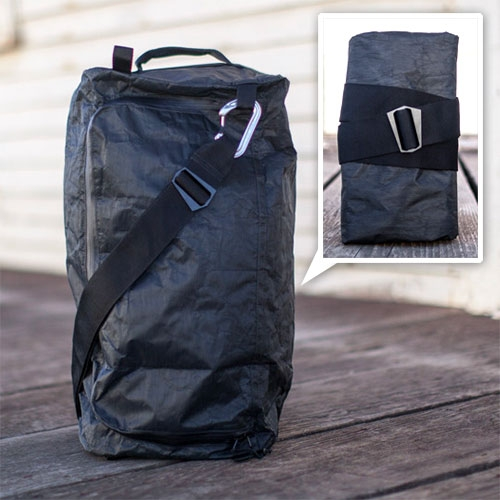 SDR Traveller's D3 Traveller Duffel - designed not to draw attention and be ultra durable (made of Dyneema). This article at Gear Junkie about it is even more fascinating than the bag itself!