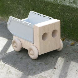 Dumper by Sam Johnson for Thorsten van Elten is a toy truck not just for kids. Made of solid beech and an off-the-shelf plastic stacking box every DIY enthusiast will know.
