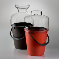 Bucket vases by Jakub Berdych of Qubus Design Studio are made of plastic buckets coupled with hand-blown glass.