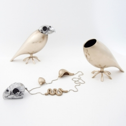 London designer Tithi Kutchamuch has created a necklace with charms modeled on the skull and entrails of a parrot
