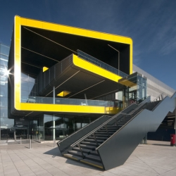 Grimshaw 's extension to the ExCeL convention centre in London has a bright yellow e-shaped entrance.