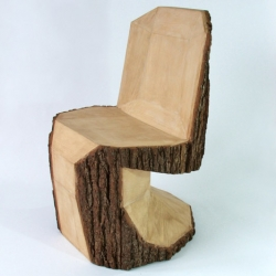 Peter Jakubik has carved the rough shape of an iconic Panton Chair into a tree trunk with a chain saw.