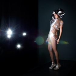 Intimacy, dresses by Dutch designers Studio Roosegaarde and V2_ are made of electrically-sensitive foils which can be either opaque or transparent depending on the currents flowing through them.