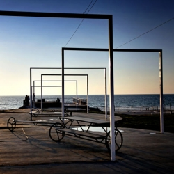 Derman Verbakel Architecture's installation in Bat Yam, Israel places furniture and arches between the city and the sea.