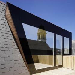Parish house extension in Zurich by Frei + Saarinen Architects.