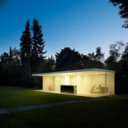 Julien Lanoo's transparent pool house in Munich, Germany by Berlin studio Baumhauer.