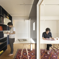 Work and relax on the same table surface with Yuko Shibata's Switch. Two mobile walls allow the interior or this Tokyo apartment to contain both living and working spaces.