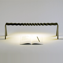 'Slim & Strong' LED table lamp by Delphine Frey uses haute-couture style pleated carbon fiber to obtain a rigid 1mm thick / 1meter long lighting object.