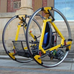 Edward, an electric dicycle–a vehicle consisting of two giant side-by-side wheels–designed and built by students at the University of Adelaide.