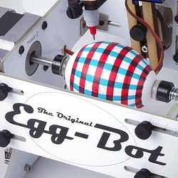 'The Eggbot' by Evil Mad Science is an open-source art robot that can draw on spherical or egg-shaped objects from the size of a ping pong ball to that of a small grapefruit.