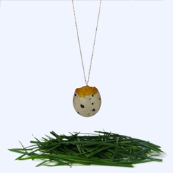 There is something so precious about wearing a fragile quail's egg shell on a necklace... with a gold leaf interior. By Stephanie Simek.