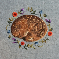 Sleeping Fawn by Chloe Giordano - canvas print. Something feels so meta about embroidering a tiny perfect little fawn on fabric, to then photograph it, then reprint it larger on canvas. How tempting it would be to embroider more on the print!