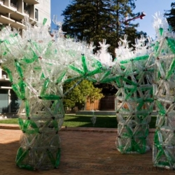 An enormous plastic rain flower from plastic water bottles, sugared beverage containers, and other scrap plastic constructions that could be used for capturing and purifying rainwater.