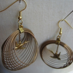 Oooh! Birdcage Earrings made by Erica Weiner.