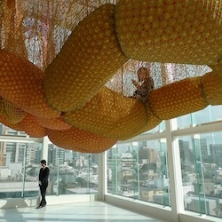 Brazilian artist Ernesto Neto's fun exhibition at Espace Louis Vuitton Tokyo is an amazing hanging canopy that visitors can walk along and get great views of central Tokyo.
