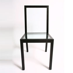 Sebastian Errazuriz's outline chair makes great use of glass to emphasize the outline of the chair.